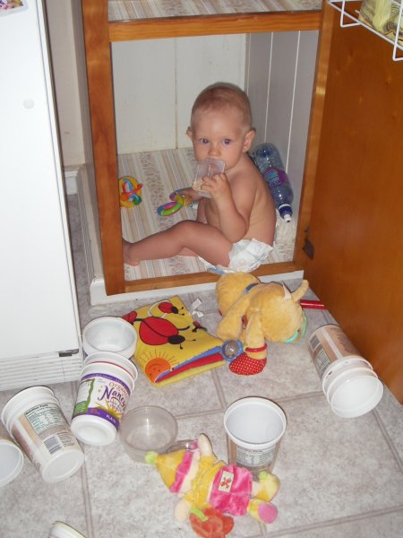 Leilani crawls inside a cupboard to find her puffs